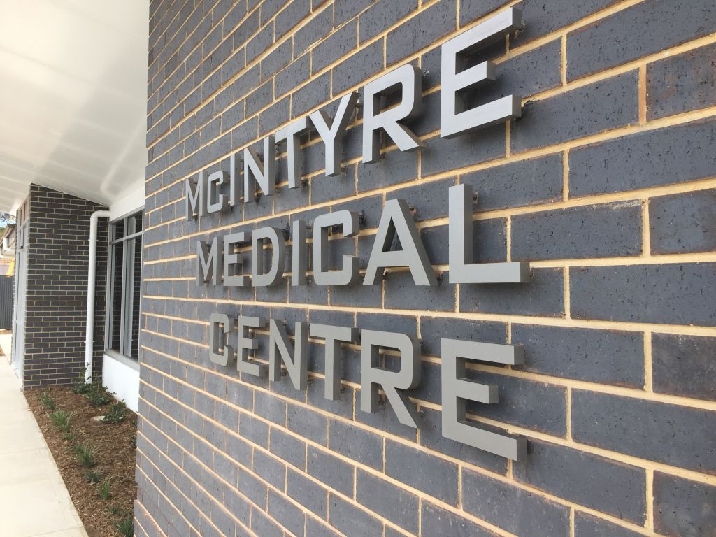 20mm thick stainless steel letters pinned off brick wall (3D251)