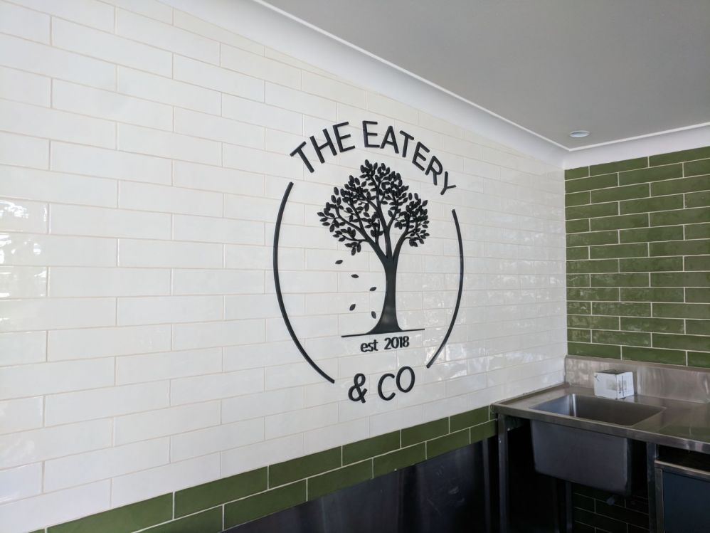10mm thick black acrylic letters to tiled wall (3D320)